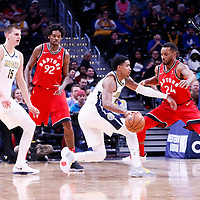 01 November 2017: Toronto Raptors forward Norman Powell (24) defends on Denver Nuggets guard Gary Harris (14) next to Toronto Raptors center Lucas Nogueira (92) and Denver Nuggets center Nikola Jokic (15) during the Denver Nuggets 129-111 victory over the Toronto Raptors, at the Pepsi Center, Denver, Colorado, USA.