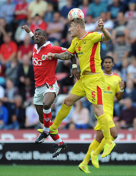 Bristol City's Kieran Agard challenges for the header with Milton Keynes Dons' Kyle McFadzean - Photo mandatory by-line: Dougie Allward/JMP - Mobile: 07966 386802 - 27/09/2014 - SPORT - Football - Bristol - Ashton Gate - Bristol City v MK Dons - Sky Bet League One