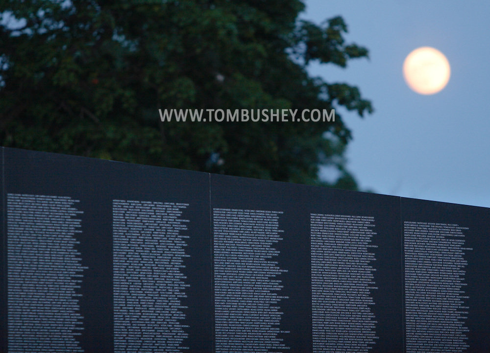 Newburgh, NY - The moon rises behind the Vietnam Veterans Memorial Moving wall at Stewart International Airport on June 6, 2009.