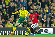 Manchester United midfielder Fred (17) goes past Norwich City defender Sam Byram (3) during the Premier League match between Norwich City and Manchester United at Carrow Road, Norwich, England on 27 October 2019.