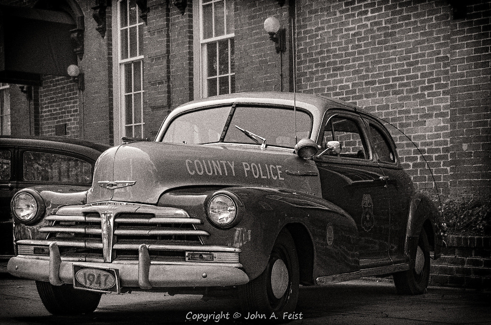 One of the great things about walking around Savannah is that you never know what is around the next corner.  We came across a group of vintage police cars on display in front of a police station.  I like the black and white treatment as that's what they would have used in 1947.