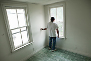 ALLENTOWN, PA – JUNE 16, 2011: Miguel Alfredo-Balcazar surveys a vacant room in a property for sale in Allentown, Pennsylvania.<br />