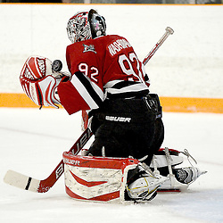 STOUFFVILLE, ON - Feb 13 : Ontario Junior Hockey League Game Action between the Stouffville Spirit Hockey Club and the Mississauga Chargers Hockey Club.  Austin Washkurak #92 of the Mississauga Chargers Hockey Club makes the save during third period game action.<br /> (Photo by Michael DiCarlo / OJHL Images)