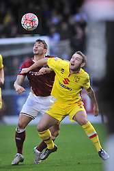 Northamptons Marc Richards battles with MK Dons Lee Hodson, Northampton Town v MK Dons, FA Cup 3rd Round,  Sixfields Stadium, Saturday 9th January 2016