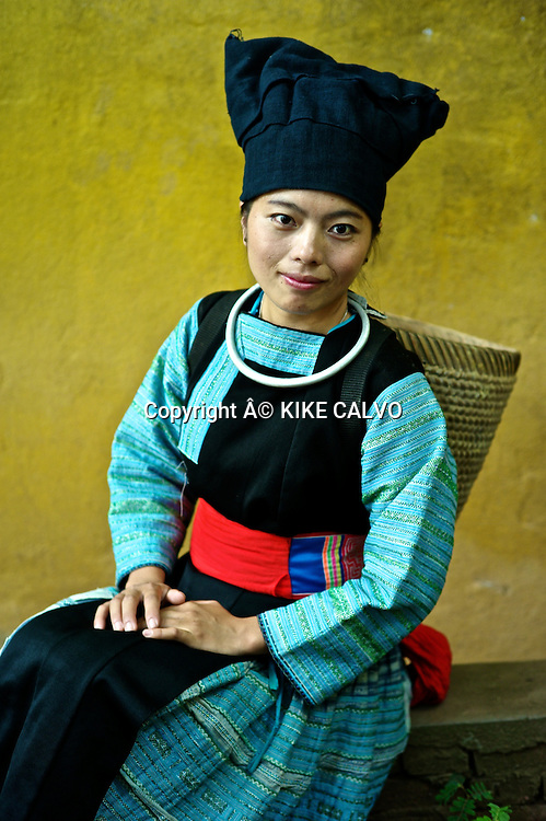 Young girl wearing a Hmong Dam traditional dress in Laos.