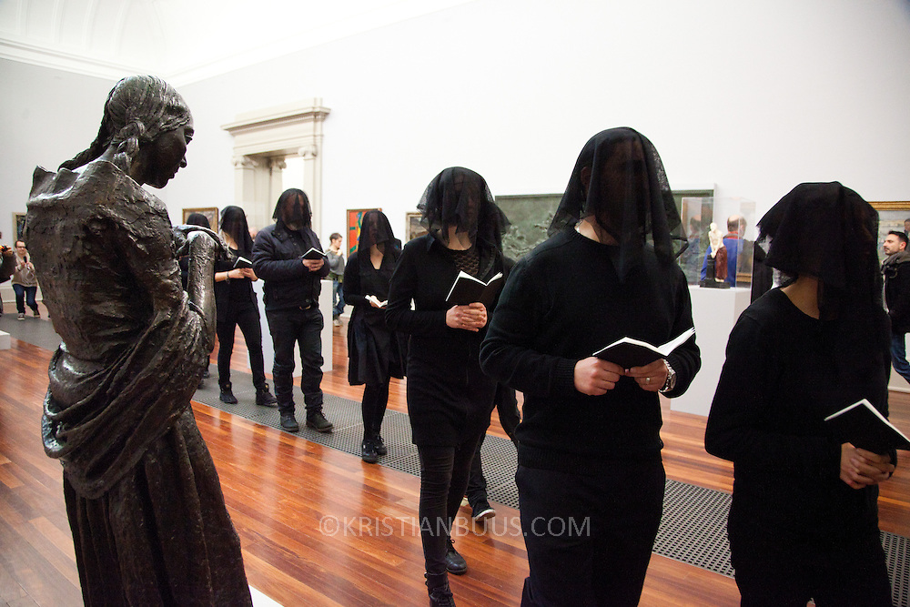 "Liberate Tate perfoms an art intervention as a political statement against BP's continued sponsorship of the Tate galleries. Parts of their press release reads:  ""Fifty veiled figures dressed in black today carried out a performance art installation entitled 'Parts Per Million' throughout a series of rooms in the 'BP Walk Through British Art' at Tate Britain during the art gallery's official re-opening (Saturday 23 November 2013). The piece critiqued the role that Tate is playing in exacerbating climate change by bolstering the public perception of BP through its long-standing sponsorship relationship."""
