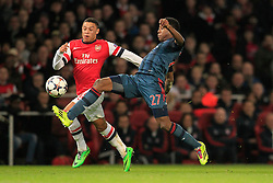 19.02.2014, Emirates Stadion, London, ENG, UEFA CL, FC Arsenal vs FC Bayern Muenchen, Achtelfinale, im Bild David Alaba (FC Bayern Muenchen #27) im Zweikampf gegen / tackling against Alex Oxlade-Chamberlain (Arsenal FC #15), Aktion, Action // during the UEFA Champions League Round of 16 match between FC Arsenal and FC Bayern Munich at the Emirates Stadion in London, Great Britain on 2014/02/19. EXPA Pictures © 2014, PhotoCredit: EXPA/ Eibner-Pressefoto/ Schueler<br /> <br /> *****ATTENTION - OUT of GER*****