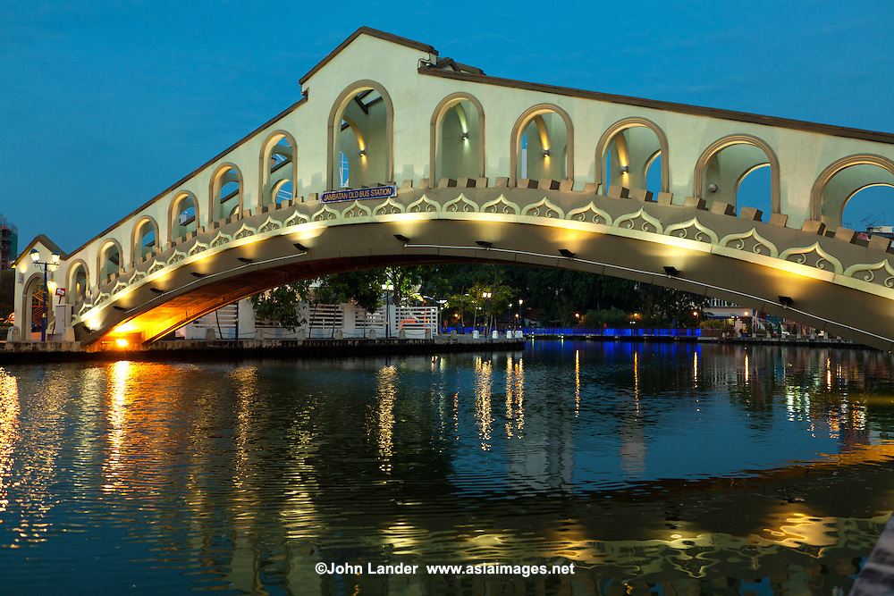 "Old Bus Station Bridge  - The Malacca River is the river that cuts across Malacca town, on its way to the Straits of Malacca. It separates the civic district clustered at the foot of St Paul's Hill, from the residential and commercial district of Heeren Street and Jonker Street. Malacca plays an important role in the development of Malacca. In the good old days the Malacca River was an important conduit for trade. In addition to being the source of fresh water it enabled access to the interior so that forest produce such as rattan, cane and resin, could to be brought down to market. As you cruise up the river, you will be able to see old shophouses along its banks. These shophouses have their warehouses, called godowns so that goods can unloaded directly from the river into them. After the Malacca Bridge near the Dutch Square, the second bridge you will pass under is the Chan Boon Cheng Bridge.  After the Chan Boon Cheng Bridge, the next bridge across the river is a foot bridge which the locals call the Ghostbridge of Malacca. How it got the name remains a mystery. Further on, another pedestrian bridge called the Old Market Bridge can be seen. The final sight before heading back on your cruise is the famous ""Kampung Morten"" and the Kampung Morten footbridge. ."