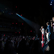 May 26, 2012 - New York, NY : Pop sensation 'One Direction,' including, from left, Louis Tomlinson, Harry Styles, and Liam Payne, perform to a sold-out crowd at the Beacon theater in Manhattan on  Saturday afternoon. The group is on the road for their first-ever headlining North American tour in support of their debut album UP ALL NIGHT. CREDIT: Karsten Moran for The New York Times