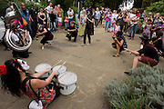 Members of the Voodoo Love Orchestra (VLO) perform to families of all ages during the Latin Music Festival at the Horniman Museum in south London.