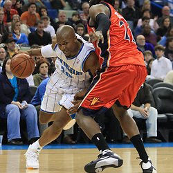 30 January 2009:  New Orleans Hornets forward David West (30) drives past Golden State Warriors forward Ronny Turiaf (21) during a 91-87 loss by the New Orleans Hornets to Golden State Warriors at the New Orleans Arena in New Orleans, LA.