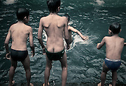 Young Balinese boys play in a bathing pool of the Holy Spring Temple - Pura Gunung Kawi Sebatu. This temple is full of beautifull pools and shrines, and is dedicated to the Goddess of Lake Batur.