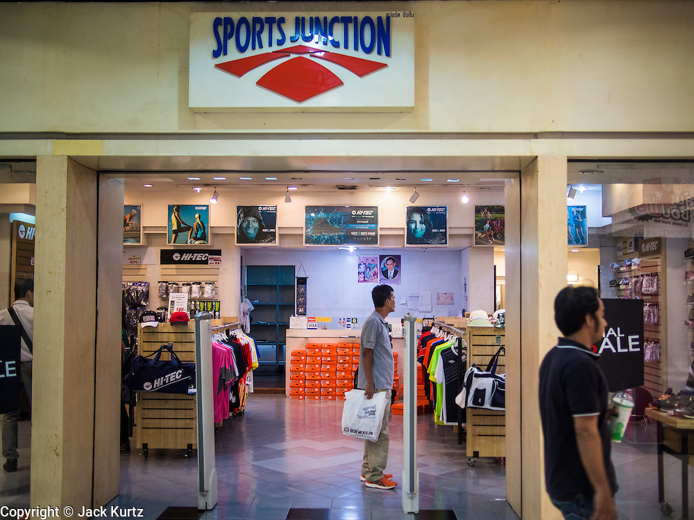 "23 AUGUST 2013 - BANGKOK, THAILAND:    A shopper in a sporting goods store in Bangkok. Thailand entered a ""technical"" recession this month after the economy shrank by 0.3% in the second quarter of the year. The 0.3% contraction in gross domestic product between April and June followed a previous fall of 1.7% during the first quarter of 2013. The contraction is being blamed on a drop in demand for exports, a drop in domestic demand and a loss of consumer confidence. At the same time, the value of the Thai Baht against the US Dollar has dropped significantly, from a high of about 28Baht to $1 in April to 32THB to 1USD in August.    PHOTO BY JACK KURTZ"