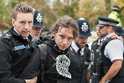 © Licensed to London News Pictures. 17/10/2015. Bristol, UK.  Police arrest Anti-Fascists on College Green.  Bristol Patriots vs Anti-Facists twin demonstrations in Bristol city centre.  The Bristol Patriots were marching against 'Somali rape gangs' and immigration, and the Anti-Fascists opposed them.  Violence flared between Anti-Fascists and police who made several arrests. Photo credit : Simon Chapman/LNP