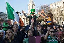 London, March 13th 2016. The annual St Patrick's Day Festival takes place in Trafalgar Square with performances on stage and plenty of Irish food and drink for the thousands of revellers.  PICTURED: A youngster enjoys an elevated view of the crowd and stage. ©Paul Davey<br /> FOR LICENCING CONTACT: Paul Davey +44 (0) 7966 016 296 paul@pauldaveycreative.co.uk