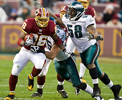 Washington Redskins running back Clinton Portis (26) sheds a tackle by Philadelphia Eagles linebacker Stewart Bradley (55) and evades Philadelphia Eagles defensive end Trent Cole (58).  The Washington Redskins defeated the Philadelphia Eagles 10-3 in an NFL football game held at Fedex Field in Landover, Maryland on Sunday, December 21, 2008.