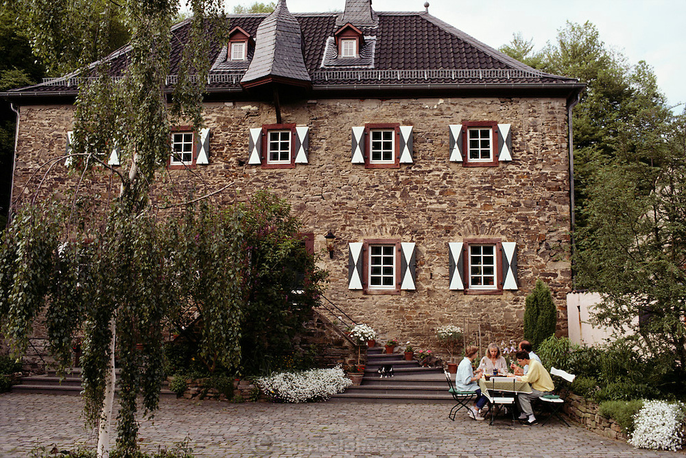 The Schmidt family eats outside their home near Cologne, Germany. MODEL RELEASED.