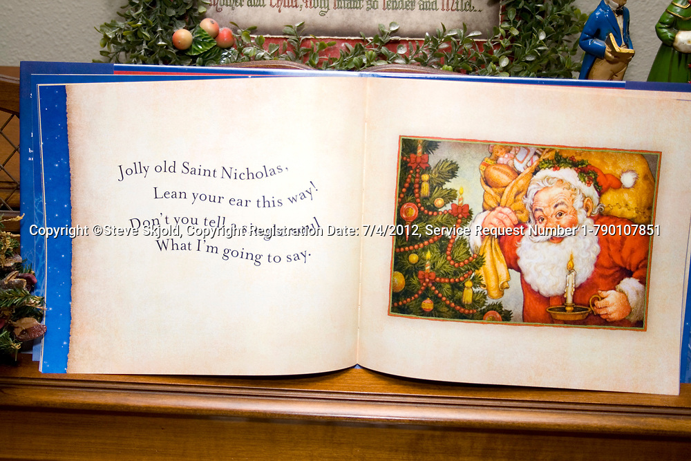Brightly colored illustrated table top book telling the Christmas story of Jolly Saint Nicholas. St Paul Minnesota MN USA