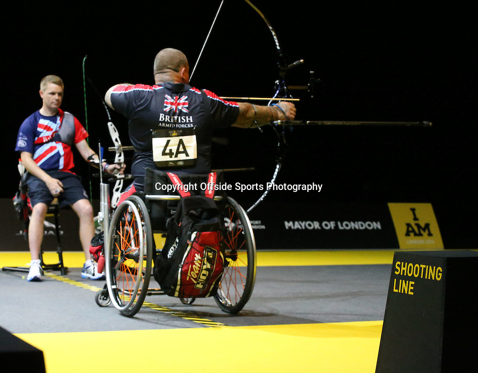 12 September 2014 - Invictus Games Day 2 - Both competitors sit on the Shooting Line in the archery.<br /> <br /> Photo: Ryan Smyth/Offside