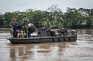 La Macarena, Meta, Colombia - 14.09.2016        <br /> <br /> Colombian soldiers on a patrol boat on the Rio Guayabero near the village La Macarena. The village was once FARC controlled, some areas arround a still part of the FARC controlled region. <br /> <br /> Kolumbianische Soldaten auf einem Patrollienboot auf dem Rio Guayabero nahe des Dorfs La Macarena. Das Dorf befand sich frueher in dem von der FARC kontrollierten Gebiet, die FARC kontrolliert auch weiterhin Teile der umliegenden Landschaft.<br /> <br /> Photo: Bjoern Kietzmann