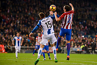 Atletico de Madrid's player Diego Godín and RCD Espanyol player David Lopez during match of La Liga between Atletico de Madrid and RCD Espanyol at Vicente Calderon Stadium in Madrid, Spain. December 03, 2016. (ALTERPHOTOS/BorjaB.Hojas)
