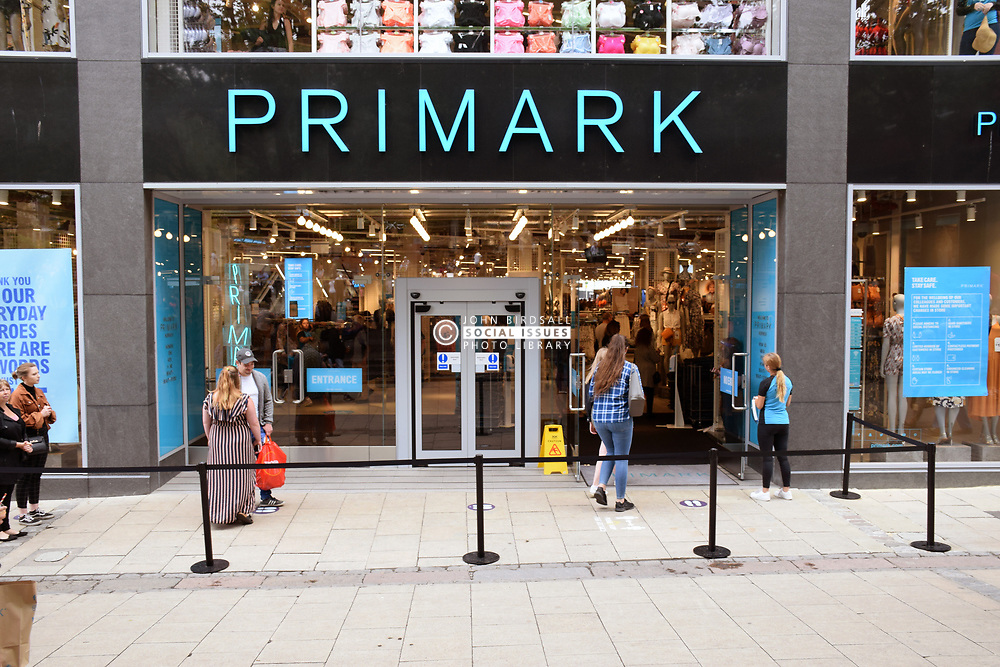 As Coronavirus lockdown eases and non-essential shops open, people queuing to get into Primark, Norwich UK June 2020
