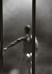 naked man outdoors by a sliding door