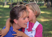 Daughter whispers to mother at picnic grounds