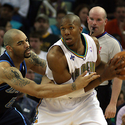 New Orleans Hornets forward David West #30 looks to pass as Utah Jazz forward Carlos Boozer #5 defends in the fourth quarter of their NBA game on April 8, 2008 at the New Orleans Arena in New Orleans, Louisiana. The Utah Jazz defeated the New Orleans Hornets 77-66.