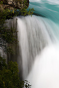 This detail of the Huka Falls shows the turquoise purity of the Waikato river, New Zealand's longest river