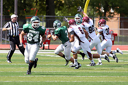 08 September 2012:  T.J. Stinde reaches for a lateral from Rob Gallik during an NCAA division 3 football game between the Alma Scots and the Illinois Wesleyan Titans which the Titans won 53 - 7 in Tucci Stadium on Wilder Field, Bloomington IL