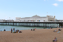 © Licensed to London News Pictures. 23/08/2014. Brighton, UK. An almost empty Brighton Beach at Brighton seafront today. Temperatures across the UK are expected to be low for the Bank Holiday weekend.  Photo credit : Hugo Michiels/LNP