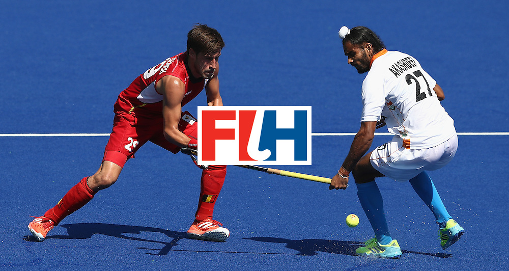 RIO DE JANEIRO, BRAZIL - AUGUST 14:  Elliot van Strydonck (L) of Belgium is challenged by Akashdeep Singh during the Men's hockey quarter final match between Belgium and India on Day 9 of the Rio 2016 Olympic Games at the Olympic Hockey Centre on August 14, 2016 in Rio de Janeiro, Brazil.  (Photo by David Rogers/Getty Images)