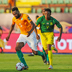 Wilfried Kanon of Ivory Coast is challenged by  Lebo Mothiba of South Africa during the 2019 Africa Cup of Nations Finals game between Ivory Coast and South Africa at Al Salam Stadium in Cairo, Egypt on 24 June 2019  <br /> Photo : Icon Sport