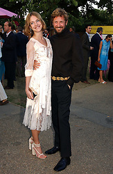 NATALIA VODIANOVA and STEFANO PILATI at the Serpentine Gallery Summer party sponsored by Yves Saint Laurent held at the Serpentine Gallery, Kensington Gardens, London W2 on 11th July 2006.<br />
