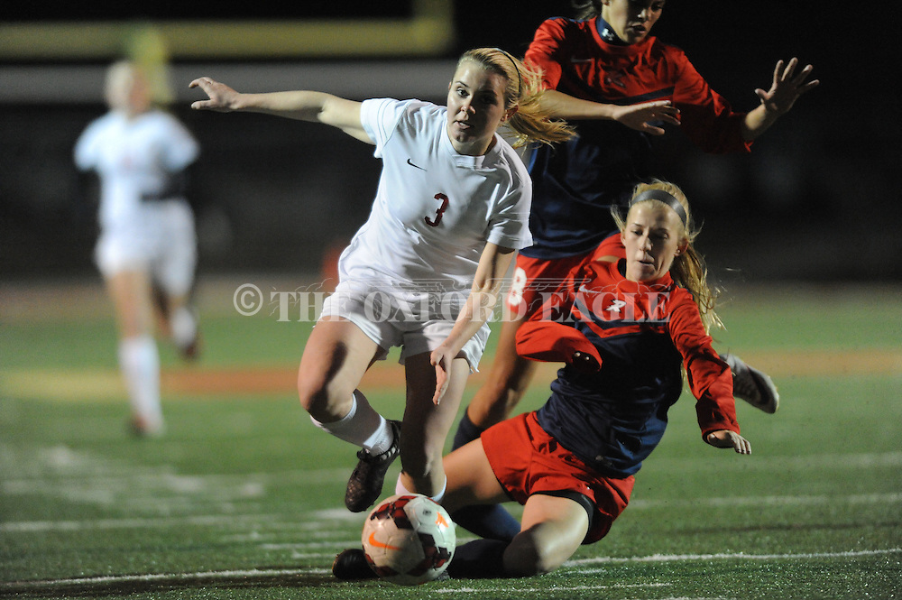 Lafayette High's Alley Houghton (3) breaks free from Richland's Aubree Patterson (6) and Julia Bain (8) in the MHSAA Class 4A North Half playoffs in Oxford, Miss. on Wednesday, February 3, 2016. Lafayette won 3-2 to advance to the state championship.