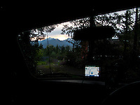 scene along a cross country trip with in a classic Mini Cooper auto - GPS says I've arrived at home in the classic Mini Cooper