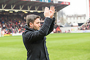 New Bristol City manager Lee Johnson applauds the fans during the Sky Bet Championship match between Bristol City and Ipswich Town at Ashton Gate, Bristol, England on 13 February 2016. Photo by Shane Healey.