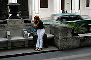 A couple kisses in public at the Prado, a pedestrian mall in Havana, Havana Province of Cuba, on Jan. 11, 2004.