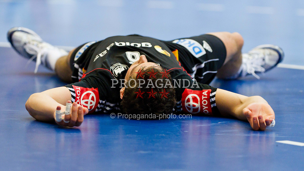 19.01.2011, Kristianstad Arena, SWE, IHF Handball Weltmeisterschaft 2011, Herren, Deutschland (GER) vs Frankreich (FRA) im Bild, // Tyskland Germany 6 Adrian Pfahl is laying on the floor after being knocked down // during the IHF 2011 World Men's Handball Championship match  Germany (GER) vs France (FRA) at Kristianstad Arena, Sweden on 19/1/2011.  EXPA Pictures © 2011, PhotoCredit: EXPA/ Skycam/ Johansson +++++ ATTENTION - OUT OF SWEDEN/SWE +++++