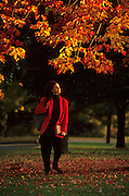 Image of a student at Amherst College in the fall, Amherst, Massachusetts, American Northeast, model released