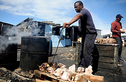 Cape Town-180906 Street vendor Phumlani Mayephu thoroughly scrubbed and rinsed well to remove all hairs. The Sheep head also know as Smiley is very popular in the township it used to be cooked only if there was traditional cremony nowadays there are many places that clean and sell this delicacy,cooked or uncooked Sheep head cost R70 and half R35 Pictures Ayanda Ndamane/African/news/agency ANA