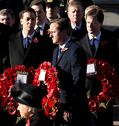© London News Pictures. 11/11/2012. London, UK. Rear L to R  Ed Miliband (Labour Party Leader), Nick Clegg (Deputy Prime Minister) and David CAmeron (British Prime Minister) holding wreaths in front of HRH Queen Elizabeth II during a Remembrance Day Ceremony at the Cenotaph on November 11, 2012 in London, United Kingdom. Photo Credit: Ben Cawthra/LNP