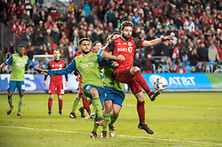 December 9, 2017 - Toronto, Ontario, Canada - Toronto FC defender DREW MOOR (3) clears the ball away from Seattle Sounders midfielder CRISTIAN ROLDAN (7) during the MLS Cup championship match at BMO Field in Toronto, Canada.  Toronto FC defeats Seattle Sounders 2 to 0. (Credit Image: © Mark Smith via ZUMA Wire)