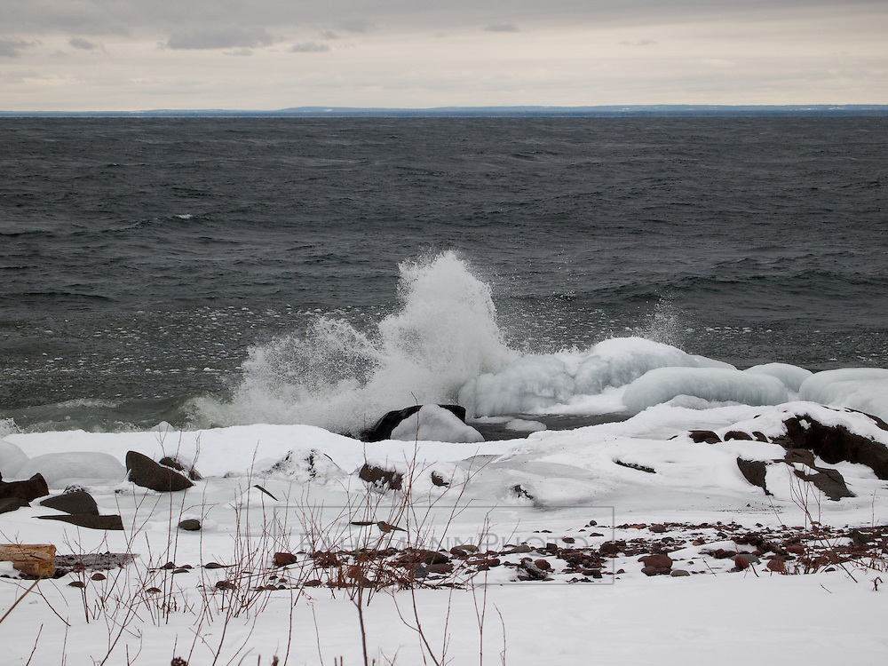 Rocky, Ice-covered shoreline of Duluth on Lake Superior