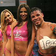 "Orlando ""El Fenomeno""  Cruz celebrates with the Capristan ring girls after defeating Gabino ""Flash"" Cota during their Boxeo Telemundo WBO/NABO Super Featherweight bout on Friday, October 9, 2015 at the Kissimmee Civic Center in Kissimmee, Florida. Cruz, who is from Puerto Rico, is the first ever openly gay boxer in the history of the sport and won the bout by unanimous decision.  (Alex Menendez via AP)"