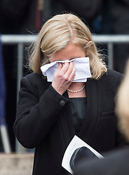 © Licensed to London News Pictures. 31/03/2018. Cambridge, UK. LUCY HAWKING (Daughter) wipes tears form her eye as at the coffin leaves the funeral of Stephen Hawking at Church of St Mary the Great in Cambridge, Cambridgeshire. Professor Hawking, who was famous for ground-breaking work on singularities and black hole mechanics, suffered from motor neurone disease from the age of 21. He died at his Cambridge home in the morning of 14 March 2018, at the age of 76. Photo credit: Ben Cawthra/LNP