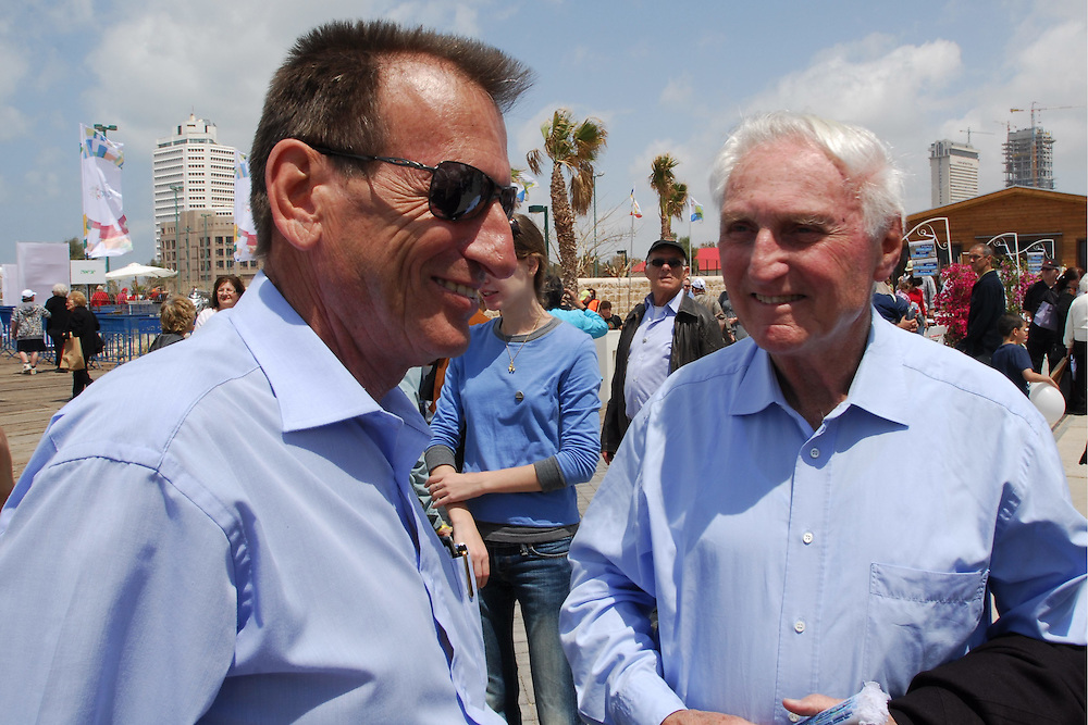 TEL AVIV, ISRAEL - Shlomo Lahat (Chich) (R), former mayor of Tel Aviv and Ron Huldai, current mayor of Tel Aviv are attending a public event in Tel Aviv on April 17, 2009. In April 1909, representatives of 66 families gathered on a sand dune north of Yafo to allocate the plots for a new neighborhood - which would later become a large metropolis, Tel Aviv. In order to divide the plots in a just manner, they held a raffle using seashells. The photograph of this raffle, taken by renown photographer Avraham Soskin, is considered the defining photograph of Tel Aviv's foundation. Exactly 100 years after this historic moments, the descendants of the 66 founding families, along with thousands of descendants of the city's builders, gathered for a commemorative photo event on Menashiya, Tel Aviv's old rail station. Photo by Gili Yaari / Flash 90 .. *** Local Caption *** úì àáéá..çâéâåú ä100..îðùéä..úçðú øøëáú..öéìåí ä100..øåï çåìãàé..øàù òéø..ùìîä ìäè....ùìîä ìäè ö'éõ'..øàù òéø úçðú øëáú..îðùééä..