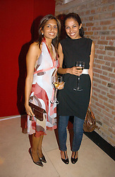 Left to right, DIVIA LALVANI and SOLONI LODHA at a party to celebrate 100 years of Chinese Cinema hosted by Shangri-la Hotels and Tartan Films at Asprey, New Bond Street, London on 25th April 2006.<br />