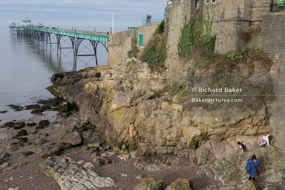 Children play on the rocks at Clevedon Pier, on 27th December 2018, in Clevedon, North Somerset, UK.
